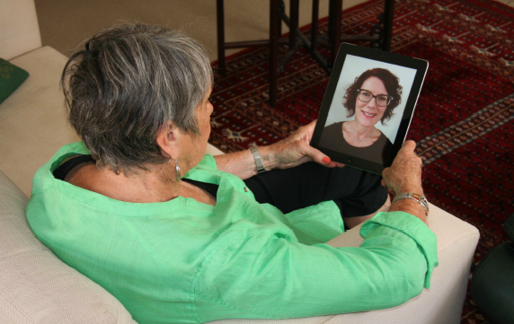 Woman having a telehealth appointment with an iPad