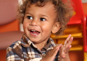 Aboriginal toddler clapping his hands