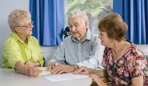 older people reading consent forms for hospital stay