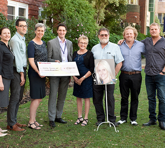 From left, Clinic members Anne Hawkins, Nik Stoyanov, Helen Mountain, Nick Pachter with member of the Sofoulis family Wendy, Darryl, Zack and Matt (with photo of Alecia).