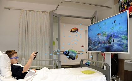 boy in bed with 3D technology