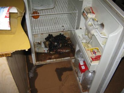 A fridge that has been damaged by floodwaters