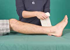 person placing bandage on leg