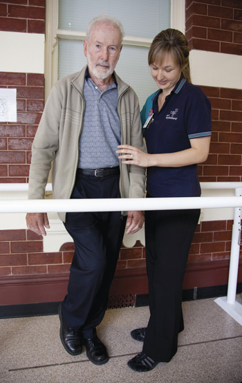 Elderly patient with physiotherapist
