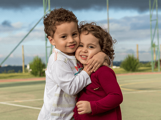 A young boy and girl hugging