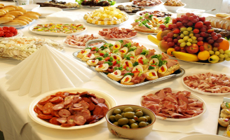 Table filled with platters of food.