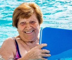Senior woman doing exercise in swimming pool