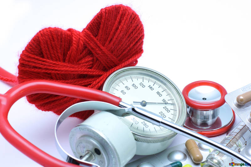 Stethoscope, blood pressure monitor and wool in the shape of a heart
