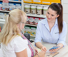 Woman talking to a pharmacist