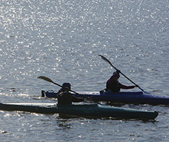 Two people in canoes on the river